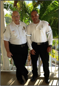 North Miami Beach Director of Police Services Tom Carney and Officer Ramon Santos